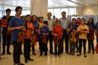 La Orquesta Escuela sorprendió al Centro Cívico con su música