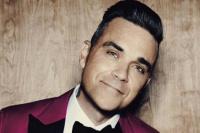 Robbie Williams entre los evacuados del incendio en Londres