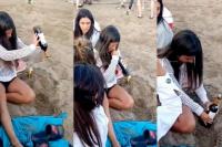 Destapó un vino en la playa sin sacacorchos y se hizo viral